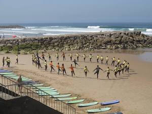 Surf-School-Teens-Camp-Lisbon-Group-warm-up