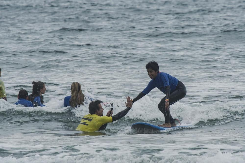 Bilbao Teens Surf Camp instructor high five