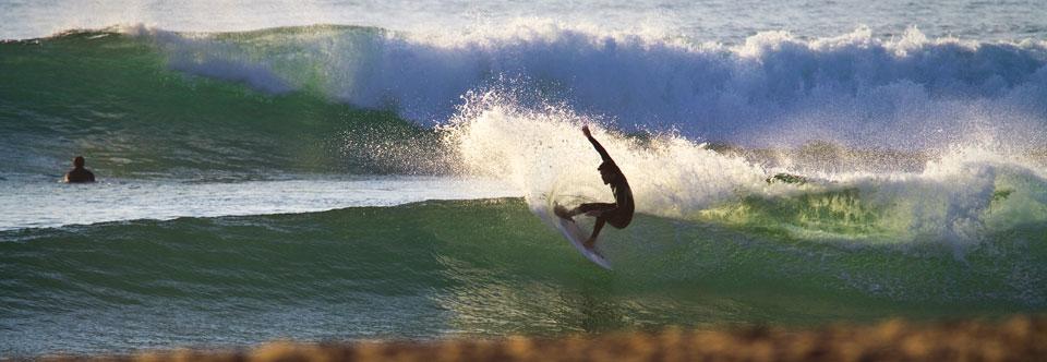 Lisbon Surf Camp Cascais - surfer wave turn