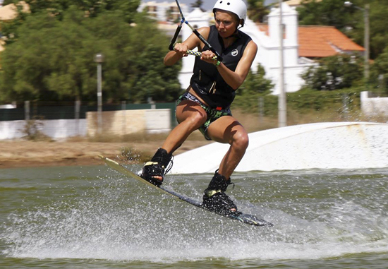 girl-jumping-wakeboarding-algarve-kitesurf-camp-1