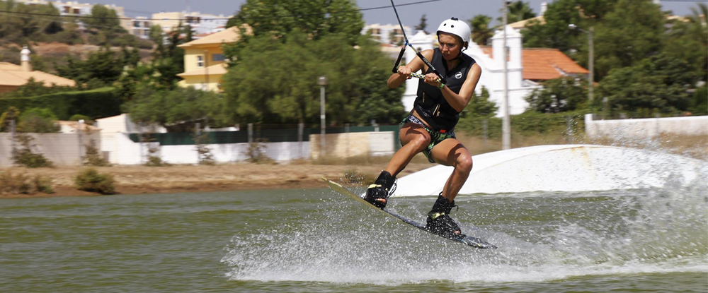 girl-jumping-wakeboarding-algarve-kitesurf-camp