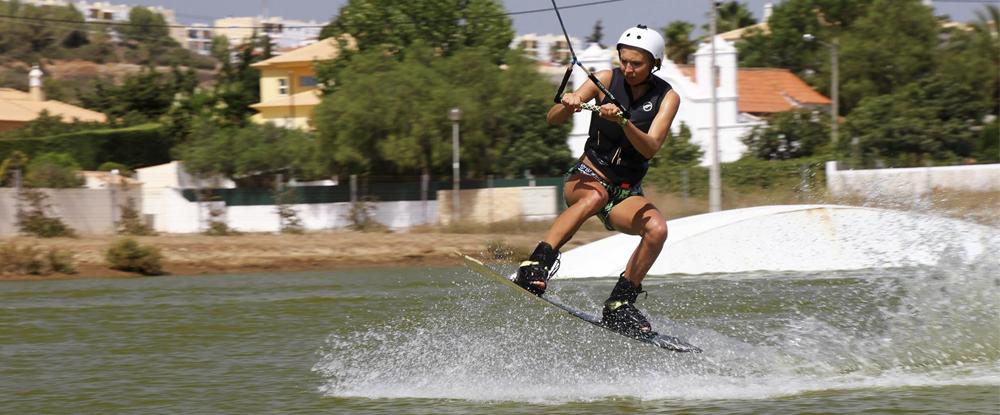 girl-jumping-wakeboarding-algarve-kitesurf-camp