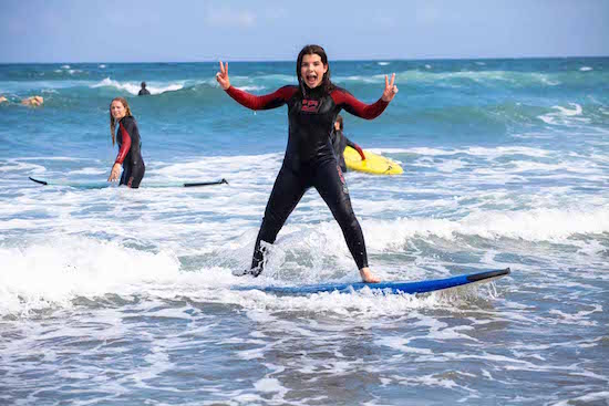 girl-surfing-bilbao-teens-surf-camp