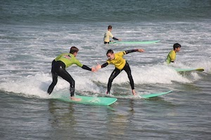 Surf School Teens Camp Lisbon Surf high five