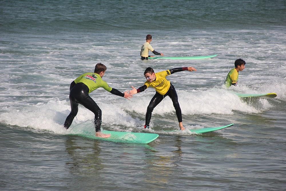 Surf School Teens Camp Lisbon Surf high five
