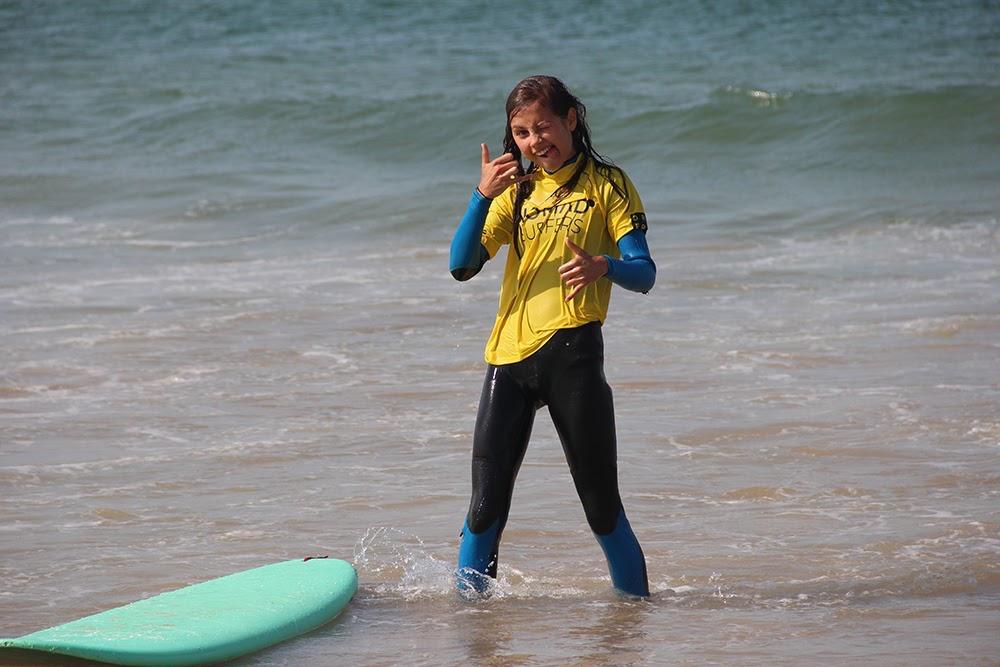 Surf School Teens Camp Lisbon after a good wave