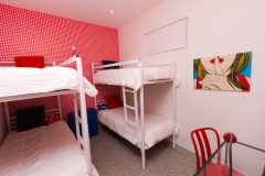 lisbon-surf-camp-cascais-accomodation-sao-pedro-do-estoril-bunk-beds-red