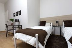 lisbon-surf-camp-cascais-accomodation-sao-pedro-do-estoril-twin-room-brown