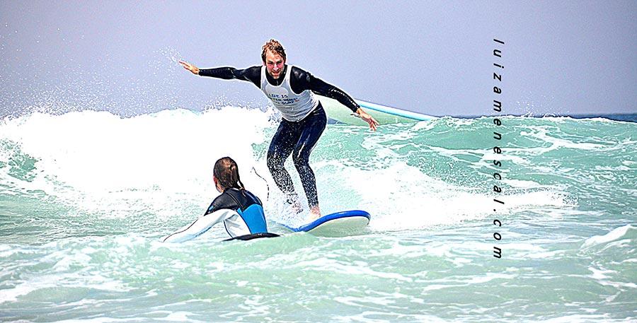 lisbon-surf-camp-cascais-beginner-surfer-catches-wave