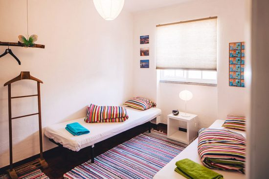 lisbon-surf-camp-cascais-guincho-country-surf-house-cascais-twin-bed-room