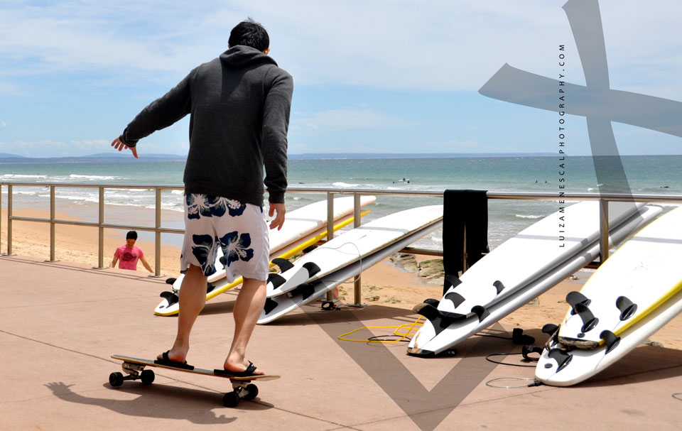 lisbon-surf-camp-cascais-skating-on-beach-surfboards