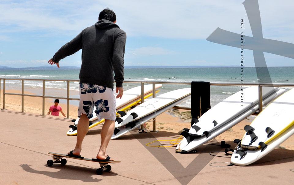 lisbon-surf-camp-cascais-skating-on-beach-surfboards