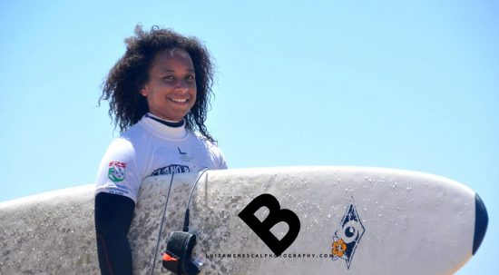 lisbon-surf-camp-cascais-smiling-surfer-face-carrying-board