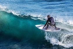 man-surfing-algarve-kitesurf-camp