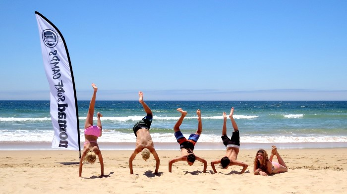 Surf-School-Teens-Camp-Lisbon-acrobatics-at-the-beach