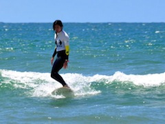 Lisbon Surf Camp Cascais - Girl riding waves shortly