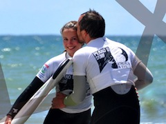 Lisbon surf camp cascais- surf couple kiss