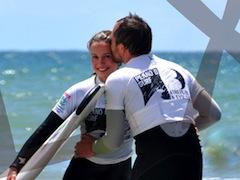 Lisbon surf camp cascais- surf couple kiss