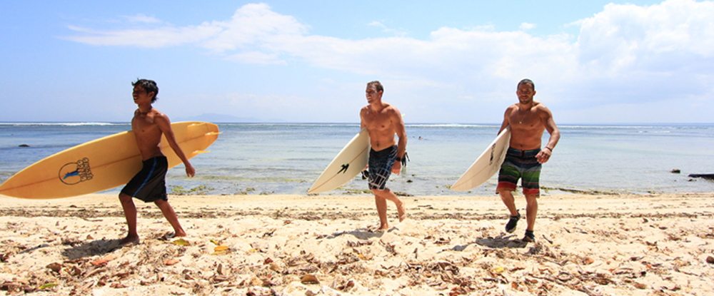 Surfers in G-Land in Indonesia