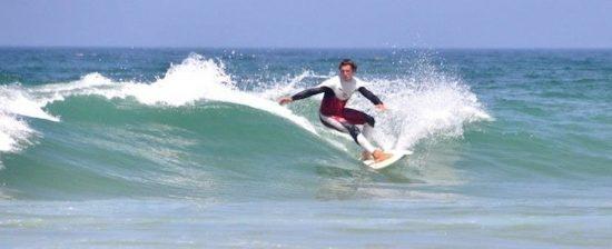 lisbon surf camp cascais - surfer riding wave