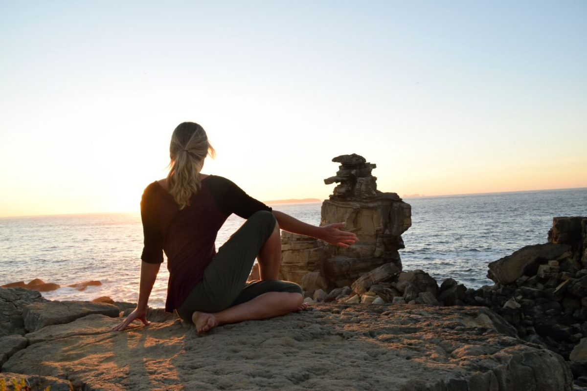 sunset yoga twist pose
