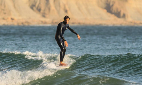 A surfer surfing a wave in Moroco