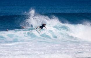 Surfing in Puaena Point Beach