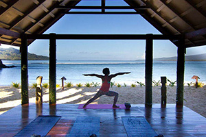 Yoga session by the beach in Fiji