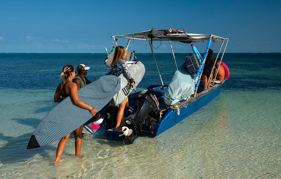 Surf coaching boat trip